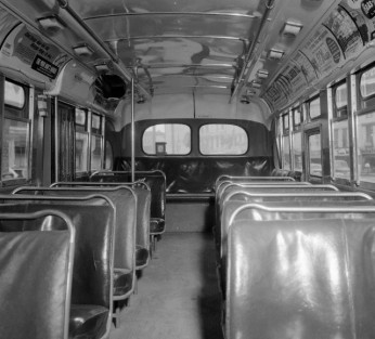 "The Montgomery bus boycott, sparked by the actions of Claudette Colvin and Rosa Parks, completely emptied the buses. Here, you can see that the signs separating the bus into ""White"" and ""Negro"" sections have been removed, though Black people in Montgomery continued to boycott the city bus line. Photo courtesy of CORBIS. © Bettmann/CORBIS"