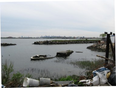 Looking southwest at artificial lagoon at the west end of Clason Point Park. The background includes: Rikers Island, Long Island City tower, Empire State Building, and Hunts Point, Bronx. May 2008.  Photo taken by Jim Henderson.