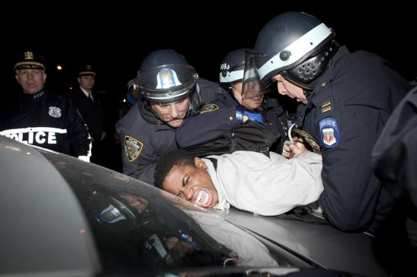 This photo of a man being arrested was taken on March 13, 2013 during a protest against the shooting of Kimani Gray. The photo is courtesy of Press TV and accessed via their Facebook Page