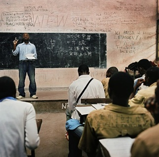 In the Republic of Congo, Jean de Dieu Malanga, a professor of Chinese, gives students at Savorgnan de Brazza high school their annual examination. Photo courtesy of Time/Paolo Woods.