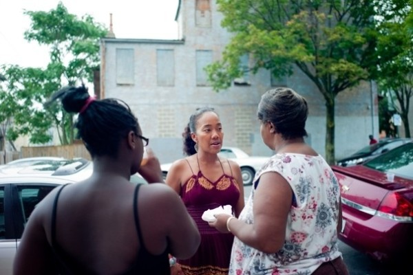 Sohn speaks with community members in Baltimore. Photo courtesy of Hector Emanuel and The Washington Post.