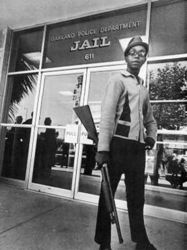 Bobby Hutton, Black Panther member, outside the Oakland Police Department Jail.