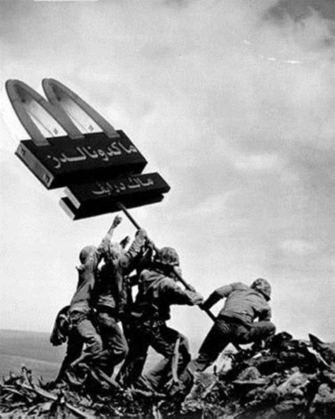 This digitally altered photo re-imagines the iconic World War II image of soldiers raising the American flag.