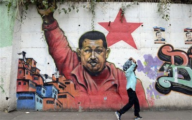 Mural of Hugo Chavez in Caracas. Photo courtesy of the Telegraph UK.