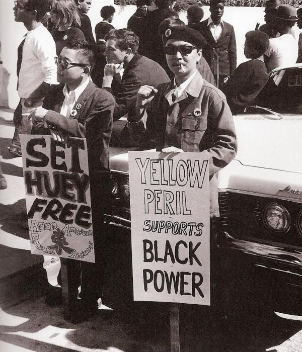 Shown: Richard Aoki displaying support for imprisoned fellow Black Panther Huey Newton.  Photo courtesy of Racialicious.com