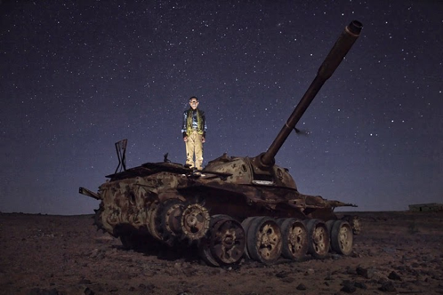 Hamdi Jaafar Mohammed, sitting atop a tank in Tifariti, Polisario controlled Western Sahara. He is soldier and member of the Polisario Front which has been fighting for the independence of the Sahrawi people for over 50 years. Photo taken by Andrew McConnell.