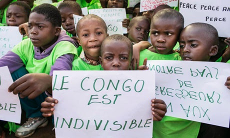 "Congolese children hold signs saying ""The Congo is Not Invisible"" during a One Billion Rising rally in Bukavu, Democratic Republic of Congo, 2013. Photo Courtesy of STRINGER/REUTERS."