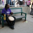 Organizer plays his drum after the closing of Saturday's events.