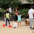 Youth dance beside a drumming jam-session.